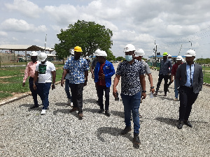 Photo of BOST officials and CSOs on tour of the BOST depot in Bolgatanga
