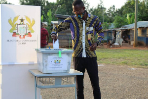 File: A voter casting his vote