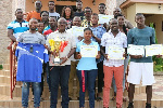 Players and officials of Akosombo Hydro Spikes with their trophy and certificates