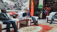 Prof. Annim, the Government Statistician (seated left) with H.E. Shi Ting Wang, the Chinese Ambassad