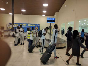 The Ghana Black Stars exiting the Gabon airport terminal.