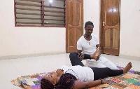 Thai Massage expert Yaw Tutu working on a client.