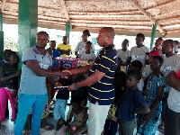 A Player of BA United presenting the items to one of the hospitals