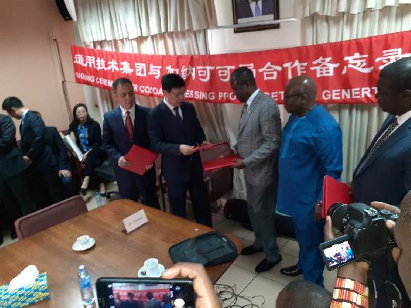 Joseph Boahen Aidoo with Zhou Qingyu