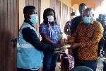 Nana Kwasi Owusu-Yeboa distributing the items at the registration centre