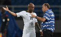 Coach Avram Grant having a chat with Andre Ayew