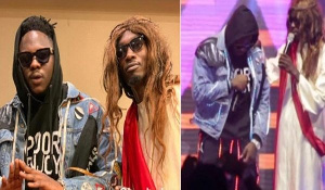 Mmebusem surprised Medikal on stage during his performance