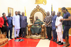 Otumfuo Osei Tutu II with officials from MIIF