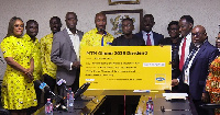 Staff of MTN presenting the cheque to board members SSNIT
