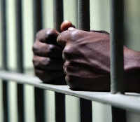Man behind prison bars.    File photo.