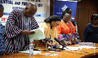 Electoral commissioners sorting out documents of political parties