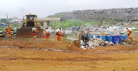 Workers of Waste Landfills fumigating the dumpsite