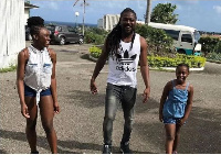 Samini with his daughters