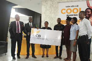 Officials handing over the GHC150,000 cheque to beneficiaries