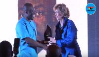 Kojo Oppong Nkrumah receiving his award at this year's MIGA