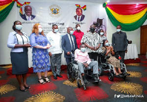 Vice President Mahamudu Bawumia assisted by the Minister of Health handed over the wheel chairs
