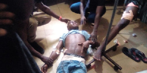 One of the persons who sustained injury surrounded by others