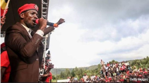 Pop star Bobi Wine is seen as a threat to President Museveni's rule