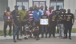 Black Bombers in a group photograph with the Ghana Olympic Committee members