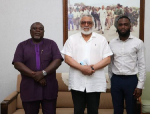 Former President Jerry John Rawlings with son of late  John Evans Atta-Mills
