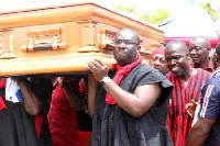 National Youth Organizer of the NPP, Sammy Awuku and others carrying a coffin