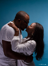 DKB kissing his 'mystery' lady