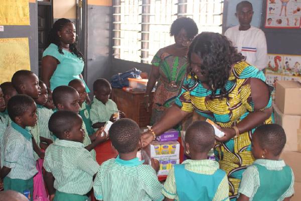 Sandra Owusu Ahenkorah interacting with some pupils of basic schools in her catchment area