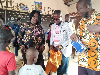 The Minister distributed educational items including school uniforms, biscuits to the pupils