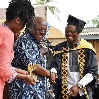 Kalybos receiving his award