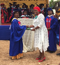 The UCOMS Best Female Student receiving her award from Ms Obuobia Darko-Opoku