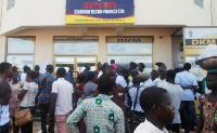 DKM customers gather in front of the micro finance office.