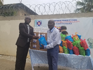 Rev. Dr. Joseph Kofi Antwi presenting the items on behalf of the church
