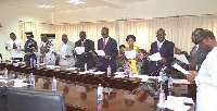 Mr Ken Ofori Atta (right), the Minister of Finance, swearing in the new Board Members of SSNIT.