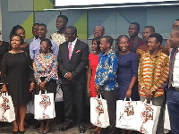 The beneficiaries in a group photograph with Ecobank MD, Mr Daniel Sackey