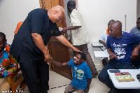 Prof. Joshua Alabi  interacting with some NDC members in the Jomoro Constituency