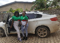 Tracey Boakye (left) with a friend by her car
