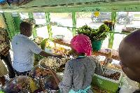 Waakye sellers serving some Patrons