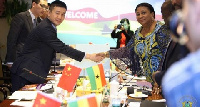 First Lady Mrs. Rebecca Akufo-Addo shaking hands with Chinese investors