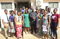 Some of the beneficiary students in a photograph with the Bongo DCE