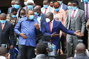President Uhuru Kenyatta (left) with his deputy William Ruto and other party members