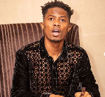 Kwesi Arthur alerts fans of a verified fake Facebook Page in his name