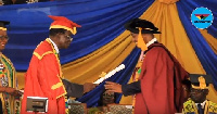 Prof. Emmanuel K. Akyeampong (L) receiving his certificate from the chairman of the school council
