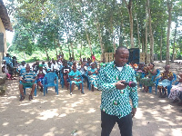 Frank Kwabena Owusu the Municipal Director of Weija-Gbawe CHRAJ interacting with the people