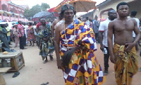 Chief fetish priest Nana Kofi Adjei clad in Kente
