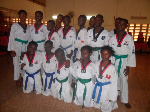 Participants in the Taekwondo competition in a group photograph