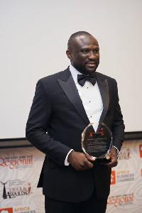 Mr. Abdul-Wahab displaying his award.