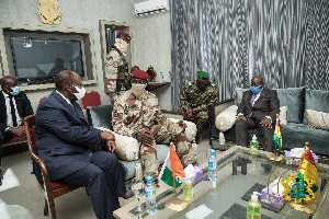 Ouattara (left) and Akufo-Addo conferring with Doumbouya in Conakry