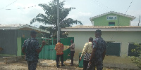 Some officials shutting down one of the unauthorised hostels
