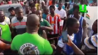 Angry voters confronting some polling officials at the Bukom center