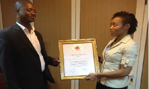 Mr.Dickson presenting the certificate of appreciation to Dr. Rawlings